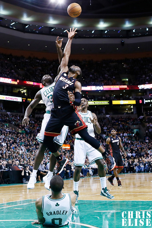 27 January 2013: Miami Heat shooting guard Dwyane Wade (3) vies for the rebound with Boston Celtics power forward Brandon Bass (30) during the Boston Celtics 100-98  2OT victory over the Miami Heat at the TD Garden, Boston, Massachusetts, USA.