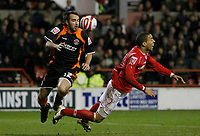 Photo: Richard Lane/Richard Lane Photography. Nottingham Forest v Blackpool. Coca Cola Championship. 13/12/2008. Gary Taylor-Fletcher (L) chases the ball as James Perch (R) goes down