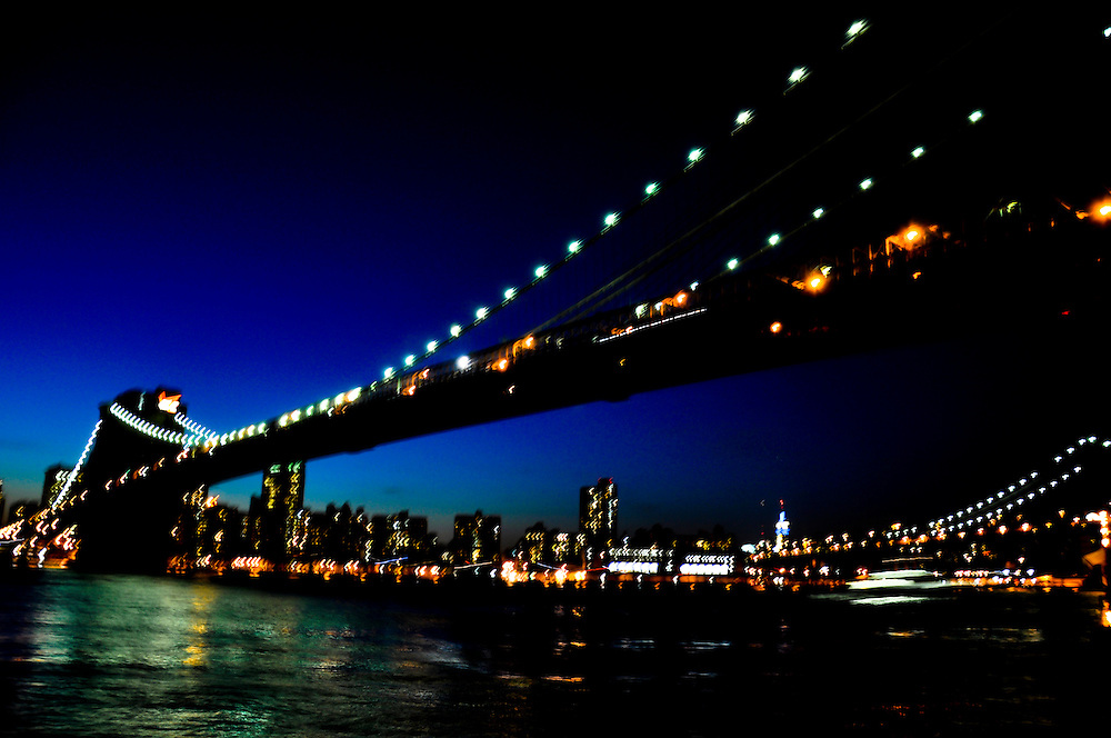 A blurry and colorful picture of the Brooklyn Bridge at sunset, Brooklyn, New york.