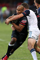 JP Pietersen attacks for the Sharks during the Super15 match between The Mr Price Sharks and The Blues held at Mr Price Kings Park Stadium in Durban on the 26th February 2011..Photo By:  Ron Gaunt/SPORTZPICS