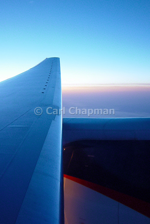 Sunset across the wing of a plane