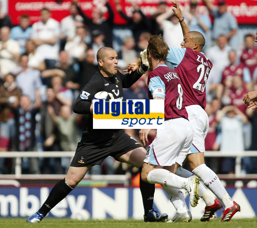 Photo: Chris Ratcliffe.<br /> West Ham United v Tottenham Hotspur. The Barclays Premiership. 07/05/2006.<br /> Teddy Sheringham and Bobby Zamora of West Ham demand the ball back from Spurs keeper Paul Robinson.