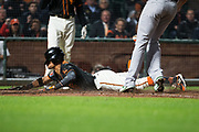 San Francisco Giants left fielder Gorkys Hernandez (7) dives into home plate against the Oakland Athletics at AT&T Park in San Francisco, California, on March 26, 2018. (Stan Olszewski/Special to S.F. Examiner)