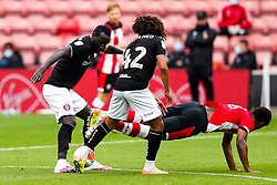 Famara Diedhiou of Bristol City is challenged during a friendly match before the Premier League and Championship resume after the Covid-19 mid-season disruption - Rogan/JMP - 12/06/2020 - FOOTBALL - St Mary's Stadium, England - Southampton v Bristol City - Friendly.