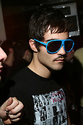 Moustached guy in sunglasses, T Bar, London.