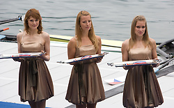 Women at medal ceremony in finish area after Men's Single Sculls  final A at Rowing World Cup  on May 30, 2010, at Bled's lake in Zaka, Bled, Slovenia. (Photo by Vid Ponikvar / Sportida)