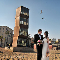 A Norweigan couple on the beach in Barceloneta, Barcelona on their wedding day.
