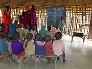 Young Maasai children learning arithmetic and reading in a school room Photographed at Lake Eyasi, Tanzania
