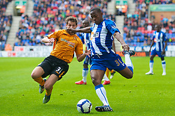 WIGAN, ENGLAND - Monday, May 3, 2010: Wigan Athletic's Maynor Figueroa and Hull City's Will Akinson during the Premiership match at DW Stadium. (Photo by David Rawcliffe/Propaganda)