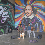 Buskers under the Southwark bridge on 18 July 2019, City of London, UK.