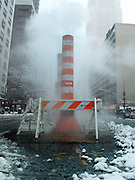 Steam rising from a vent where construction is being done on Eight Avenue in Midtown Manhattan, New York City, on a winter day