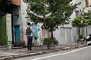 One of Rosmery's sons walks to school early in the morning,  São Paulo, Brazil
