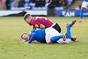 Bradford City midfielder Harry Pritchard foul the opponent during the EFL Sky Bet League 2 match between Macclesfield Town and Bradford City at Moss Rose, Macclesfield, United Kingdom on 30 November 2019.