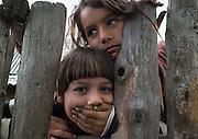Two Roma girls in the all-Roma village of Poiana Negustiorului in Bacau County, Romania.