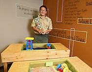 Kenny Plume, 14, of Cedar Rapids, stands next to the sensory tables he built for his Eagle Scout project at the Arc of East Central Iowa, 680 2nd St SE #200, in Cedar Rapids on Wednesday afternoon, May 16, 2012. (Stephen Mally/Freelance)