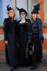 © Licensed to London News Pictures. <br /> 01/11/2014. <br /> <br /> Whitby, Yorkshire, United Kingdom<br /> <br /> Women wearing Gothic Victoriana clothing pose for a picture during the Whitby Goth Weekend. <br /> <br /> The event this weekend brings together thousands of extravagantly dressed followers of Victoriana, Steampunk, Cybergoth and Romanticism who all visit the town to take part in celebrating Gothic culture. This weekend marks the 20th anniversary since the event was started by local woman Jo Hampshire.<br /> <br /> Photo credit : Ian Forsyth/LNP