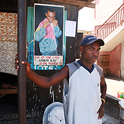 Ghana. Accra. The small and poor area of Bukom is the heartbeat of Ghanian boxing and has produced several world class fighters. Boxer Annor Ray with his poster.