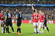 Referee from Spain Antonio Mateu Lahoz shows a yellow card to Ruud Vormer of Club Brugge during the Champions League Qualifying Play-Off Round match between Club Brugge and Manchester United at the Jan Breydel Stadion, Brugge, Belguim on 26 August 2015. Photo by Phil Duncan.