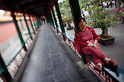 Imperial Summer Palace (Yihe Yuan). Long Corridor. Woman having a nap.