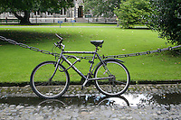 Bicycle locked to chain fence at Trinity College Dublin Ireland