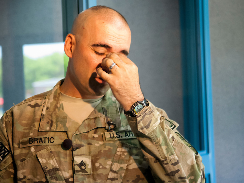 "Lathan Goumas | MLive.com..United States Army Staff Sergeant Luis Bratic takes a moment as he talks with reporters before surprising his 10-year-old son Christopher Bratic during a school assembly at Lillian G. Mason Elementary Scho in Grand Blanc Township, Mich. on Thursday June 7 2012. Bratic returned home from an 11-month deployment if Afghanistan. ""It was exciting, best thing in the world,"" he said after the surprise occurred."