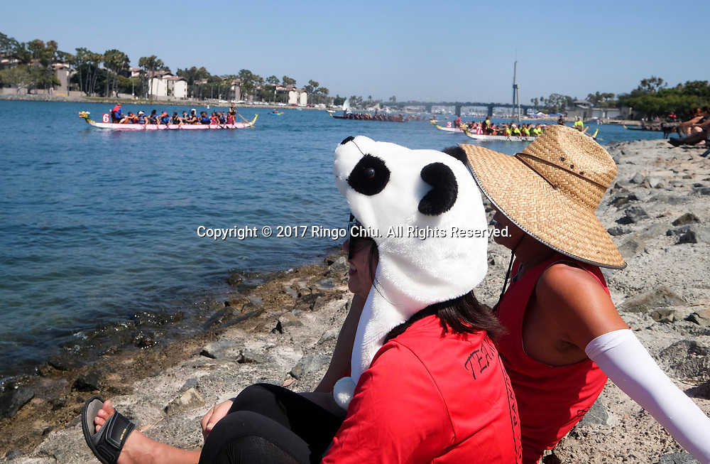 People watch as dragon boat racers prepare to compete at Long Beach Dragon Boat Festival at Marine Stadium in Long Beach, California, on July 30, 2017. (Photo by Ringo Chiu)<br /> <br /> Usage Notes: This content is intended for editorial use only. For other uses, additional clearances may be required.