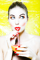 beautiful woman portrait drink grapefruit juice with straw studio on yellow background