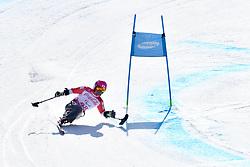 SUZUKI Takeshi LW12-2 JPN competing in ParaSkiAlpin, Para Alpine Skiing, Super G at PyeongChang2018 Winter Paralympic Games, South Korea.