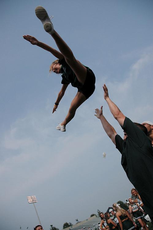 Mike Lindroos spots Erin Ginley, both Alumni Cheerleaders