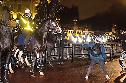 © Licensed to London News Pictures. 05/11/2015. London, UK. Demonstrators clash with riot police outside Buckingham palace during An anti-capitalist  protest organised by the group Anonymous outside Parliament in Westminster on bonfire night 05, November 2015. Bonfire night, also known as Guy Fawkes night, is an annual commemoration of when Guy Fawkes, a member of the Gunpowder Plot, was arrested for attempting to blow up the House of Lords at parliament.   Photo credit: Ben Cawthra/LNP