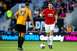 Harry Maguire of Manchester United takes on Leander Dendoncker of Wolverhampton Wanderers - Mandatory by-line: Robbie Stephenson/JMP - 19/08/2019 - FOOTBALL - Molineux - Wolverhampton, England - Wolverhampton Wanderers v Manchester United - Premier League