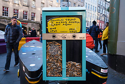 Ballot Bin using cigarette butts/ends to allow voting on street on Royal Mile in Edinburgh, Scotland, United Kingdom