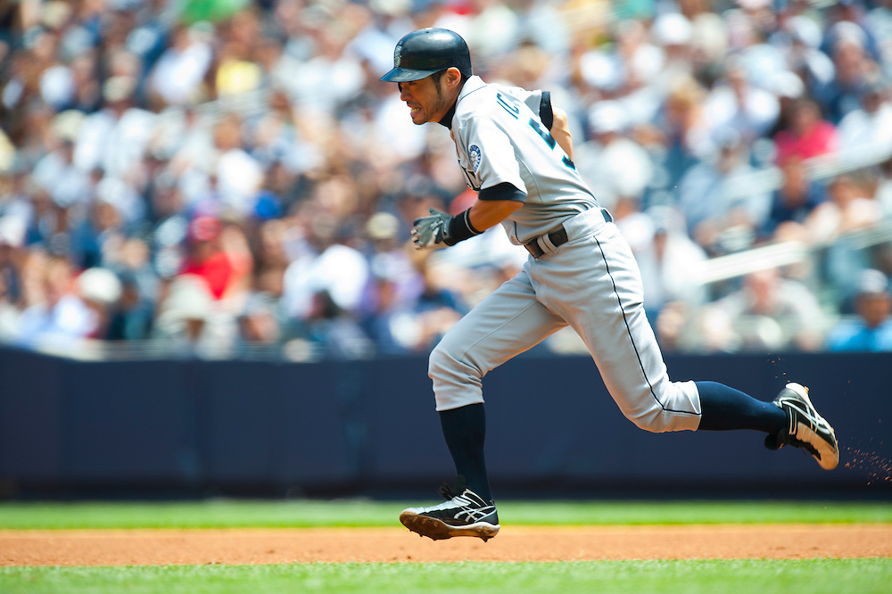 NEW YORK - JULY 27: Ichiro Suzuki #51 of the Seattle Mariners attempts to steal second during the game against the New York Yankees at Yankee Stadium on July 27, 2011 in the Bronx borough of Manhattan. (Photo by Rob Tringali) *** Local Caption *** Ichiro Suzuki