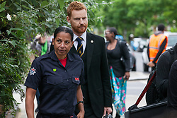 London, UK. 14th June, 2018. Paul Embery and Lucy Masoud of the Fire Brigades Union arrive for the Grenfell Memorial Service at St Helen's Church.