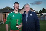 St John's Lennon Mitchell receives the man of the match award from DFCSS' Dave Forbes - Grove (white) v. St.John's (tangerine) in the U17 George Grant Memorial Trophy Final (sponsored by DFCSS) at Whitton Park, Dundee, Photo: David Young<br /> <br />  - &copy; David Young - www.davidyoungphoto.co.uk - email: davidyoungphoto@gmail.com