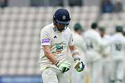 Wicket - Liam Dawson of Hampshire thumps his bat in anger as he leaves the field after being dismissed by Travis Head of Worcestershire during the Specsavers County Champ Div 1 match between Hampshire County Cricket Club and Worcestershire County Cricket Club at the Ageas Bowl, Southampton, United Kingdom on 13 April 2018. Picture by Graham Hunt.