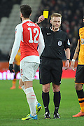 Olivier Giroud of Arsenal FC (12) receives yellow card during the The FA Cup fifth round match between Hull City and Arsenal at the KC Stadium, Kingston upon Hull, England on 8 March 2016. Photo by Ian Lyall.