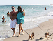 Simon Cowell, Lauren Silverman, and their new son Eric spend another relaxing day at the beach with friends and family.   Simon walked the dogs and chatted on his cellphone. Simon and Lauren stopped for a bit waterside to let the dogs play. Miami Beach, FL. 24th February 2014.<br /> ©Exclusivepix