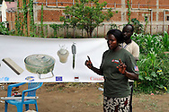 A MAG community liaison team giving Mine Risk Education to people living in an area where a huge number of unexploded ordinance were found just opposite John Garang's tomb in Juba as the area was being prepared for South Sudan independence ceremonies. The Government of South Sudan called on Mines Advisory Group (MAG) to assist SPLA deminers in an attempt to clear the area and make it safe for the thousands of people and dignitaries who will be attending the declaration of independence on July 9th..Juba, South Sudan. 04/07/2011..Photo © J.B. Russell