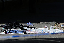 © Licensed to London News Pictures. 01/06/2019. London, UK. Blood soaking clothing of the victim on Seven Sisters Road, near the junction of Vartry Road in Haringey, north London, where a man in his 30s was found suffering from a stab wound to his leg. Police were called by London Ambulance Service just after 3am on Saturday, 1 June 2019. The victims condition in unknown.  Photo credit: Dinendra Haria/LNP