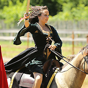 Iva Slavtcheva, portraying Lady Vera from Portugal, participated in the jousting competition at the Highland Renaissance Festival in Eminence, Ky., on 6/19/10. The jousting tournament was performed by the Cavalo Equestrian Arts troupe out of Florida. Photo by David Stephenson