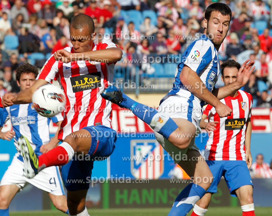 02.05.2012, Vicente Calderon Stadion, Madrid, ESP, Primera Division, Atletico Madrid vs Real Sociedad, Ersatztermin, im Bild Atletico de Madrid's Joao Miranda (l) and Real Sociedad's Imanol Agirretxe // during the football match of spanish 'primera divison' league, alternate date, between Atletico Madrid and Real Sociedad at Vicente Calderon stadium, Madrid, Spain on 2012/05/02. EXPA Pictures © 2012, PhotoCredit: EXPA/ Alterphotos/ Acero..***** ATTENTION - OUT OF ESP and SUI *****
