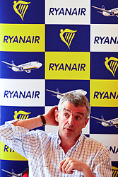 © under license to London News Pictures. 31/03/2011.  Michael O'leary, CEO of Ryanair, discusses with journalists his decision to add a £2 compensation levy to every ticket. The move comes just days after Ryanair was criticised for the size of its payment surcharge which can amount to £40 for a family of four. Photo credit should read Cliff Hide/LNP.