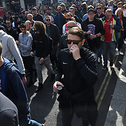 AFC Ajax (ultras football)supporters march and salute in Charing Cross road, London, UK on 30 April 2019.