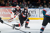 KELOWNA, CANADA - FEBRUARY 28: Loch Morrison #8 of Calgary Hitmen blocks a shot against the Kelowna Rockets on February 28, 2015 at Prospera Place in Kelowna, British Columbia, Canada.  (Photo by Marissa Baecker/Shoot the Breeze)  *** Local Caption *** Loch Morrison;