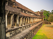 "13 MARCH 2015 - SIEM REAP, SIEM REAP, CAMBODIA: The north wall of Angkor Wat.  The area known as ""Angkor Wat"" is a sprawling collection of archeological ruins and temples. The area was developed by ancient Khmer (Cambodian) Kings starting as early as 1150 CE and renovated and expanded around 1180CE by Jayavarman VII. Angkor Wat is now considered the seventh wonder of the world and is Cambodia's most important tourist attraction.   PHOTO BY JACK KURTZ"
