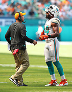 Sep 23, 2018; Miami Gardens, FL, USA; Miami Dolphins head coach Darren Rizzi gives instruction to Dolphins defensive end Robert Quinn (94) at Hard Rock Stadium against the Oakland Raiders. The Dolphins defeated the Raiders 28-20. (Steve Jacobson/Image of Sport)