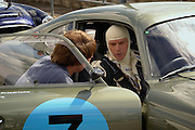 Aston Martin enthusiast Wolfgang Friedricks goes over some last minute strategy before racing in his extremely rare 1962 DP212 project car at Silverstone Circuit in England. Part of the Historic racing series.