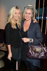 Left to right, MOLLIE KING and AMANDA BRETHERTON President of Next Model Management at the mothers2mothers World AIDS Day VIP Lunch with Next Management & THE OUTNET.COM held at Mondrian London, 19 Upper Ground, London on 1st December 2014.