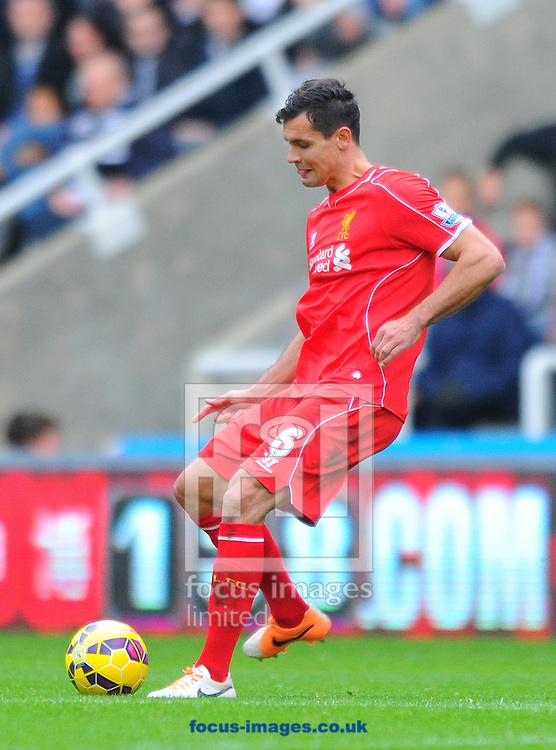 Dejan Lovren of Liverpool passes the ball during the Barclays Premier League match at St. James's Park, Newcastle<br /> Picture by Greg Kwasnik/Focus Images Ltd +44 7902 021456<br /> 01/11/2014
